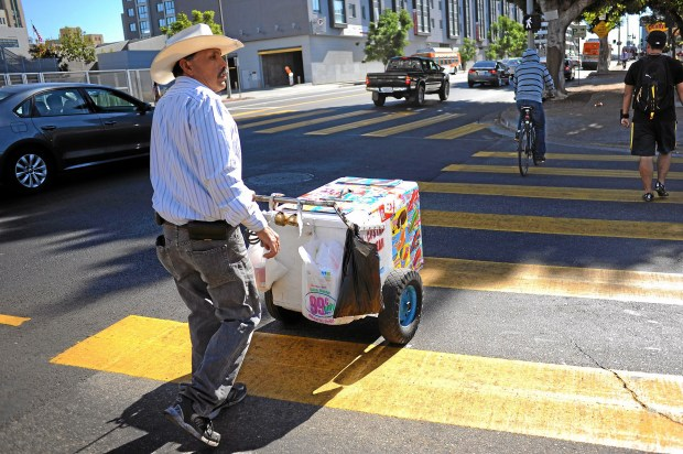 A street vendor pushes his cart in downtown Los Angeles.