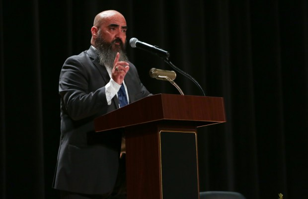 Frank Hinojoz, Director of the John Glenn High School Band speaks during the plaque dedication ceremony. The Norwalk-La Mirada Unified School District dedicates a plaque to Lee Mitchell, a retired band director and the first African-American teacher in the district on Saturday, Oct. 14, 2017. (Photo by Shilah Montiel for SCNG)