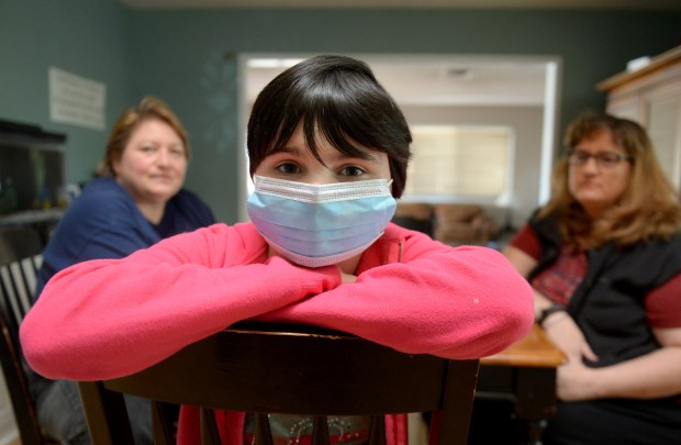 Adriana Perez (right), her partner Evon, and their daughter Cassidy, 14, struggle with Cassidy's illness, which is aplastic anemia. Adriana said she believes her daughter came down with the anemia because of toxins in the air due to the Aliso Canyon gas leak. (Photo by Dean Musgrove/Los Angeles Daily News/SCNG)