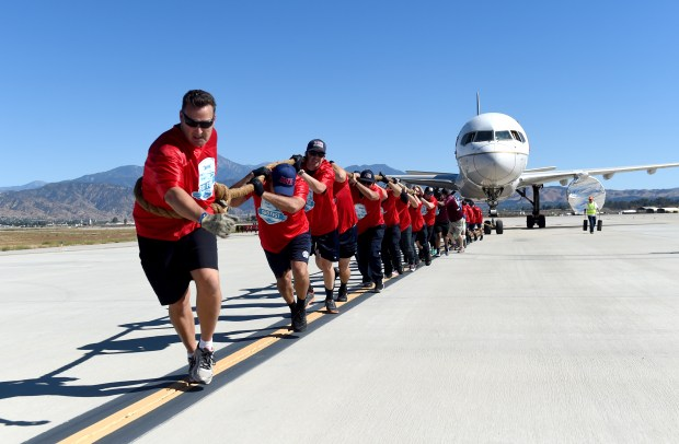 Assistant Fire Chief Dan Munsey leads the San Bernardino County Fire Department team during the SB Strong Plane Pull at the Third annual SBD Fest air show at San Bernardino International Airport in San Bernardino on Sunday, October 22, 2017. (Photo by John Valenzuela, The Sun/SCNG)