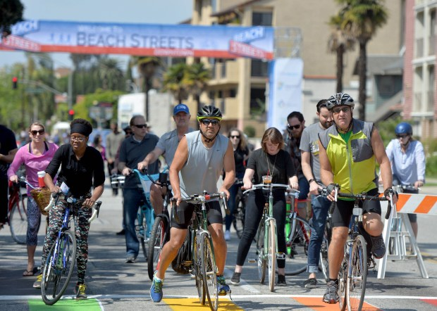 The Beach Streets Downtown bike festival closed off a 4-mile stretch of Broadway in downtown and Alamitos Beach to all cars Saturday allowing residents to get exercise and fresh air on their bikes, roller blades, skate boards and feet. The route offered plenty of shopping, entertainment, dining and neighborhood outreach. Long Beach March 19, 2016. (Photo by Brittany Murray / Press Telegram)