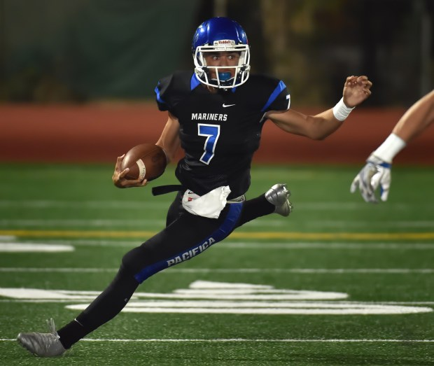 Pacifica's Ben Jefferson takes the ball downfield in the first quarter of an Empire League football game against Tustin at Garden Grove High.Steven Georges, Contributing Photographer