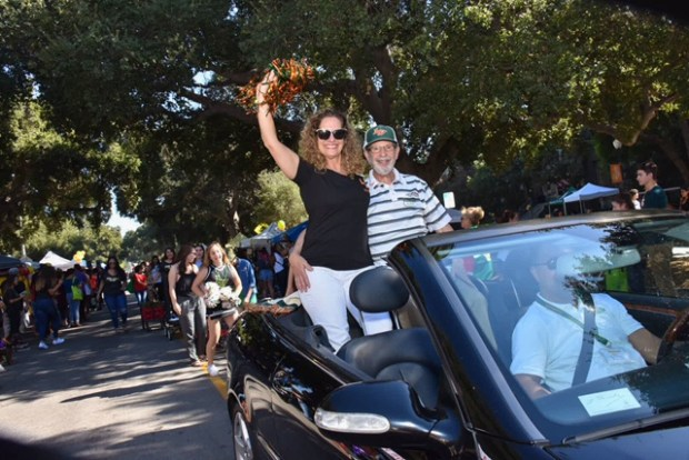 University of La Verne President Devorah Lieberman and her husband, Roger Auerbach, wave during the homecoming weekend float parade at the university on Saturday. Homecoming events were expected to draw about 1,500 guests for events such as a fun run/walk, a reunion brunch, tailgate party, and a football game. (Courtesy photo)