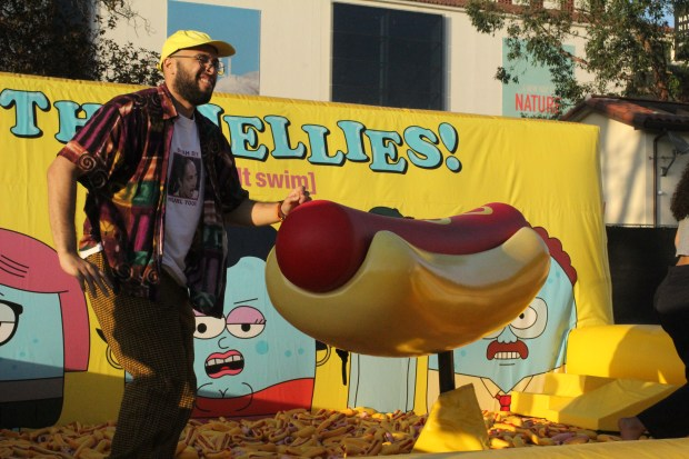 The face of defeat, as a fan walks away from the mechanical hot dog ride at Camp Flog Gnaw at Exposition Park in Los Angeles on Saturday, Oct. 28, 2017. (Photo by Kenya Barrett/SCNG)