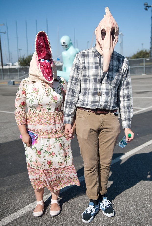 """Julie Mireles and Emanuel Aceves, both of Moreno Valley, pose in their """"Beetlejuice""""-inspired Halloween costumes during The Growlers 6 festival at the LA Waterfront in San Pedro on Saturday, October 28, 2017. (Photo by Nick Agro, Orange County Register/SCNG)"""