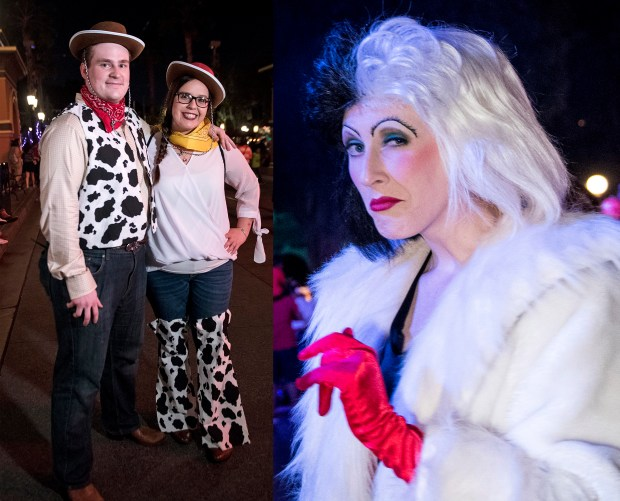 A fondness for Dalmatian spots might be the only thing this Toy Story couple at Disney California Adventure and Cruella de Vil at Disneyland have in common. (Photo by Cindy Yamanaka, Orange County Register/SCNG)