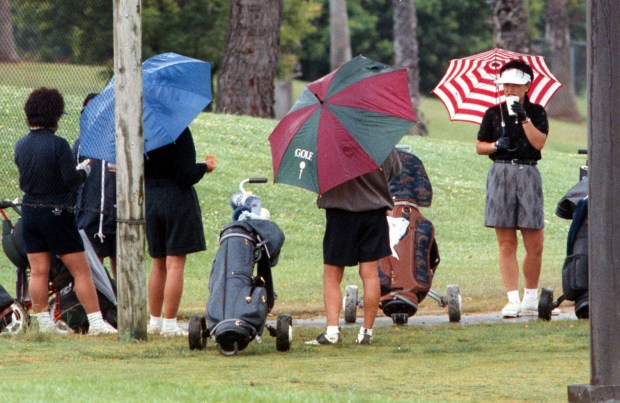 File photo of golfers waiting their turn on the 10th tee as they continue to play amidst the drizzling rain at La Mirada Golf Course. (SGVN file photo)