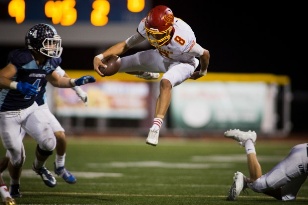 Woodbridge's Nick Nash, leaps to evade a tackle during the game against University in Irvine on Friday, October 27, 2017. (Photo by Foster Snell, Contributing Photographer)