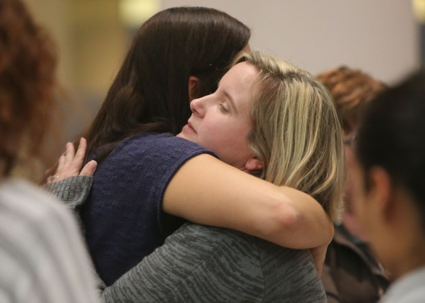 Sally Cardinale, a Dec. 2 shooting victim, right, is consoled by her sister, Angela Cardinale, of Redlands, at the end of a San Bernardino County Board of Supervisors' special meeting regarding the workers' compensation issues on Monday, Nov. 28, 2016. (Stan Lim, The Press-Enterprise/SCNG)