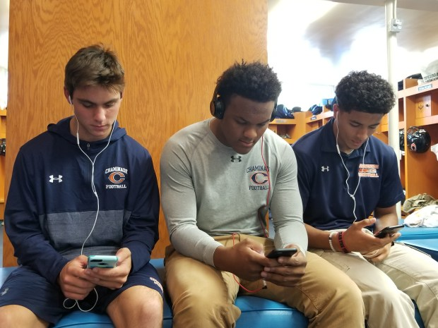 Chaminade's Ryan Stevens, Andrew Van Buren and Michael Wilson look up their favorite music (Photo by Evan Barnes/SCNG)