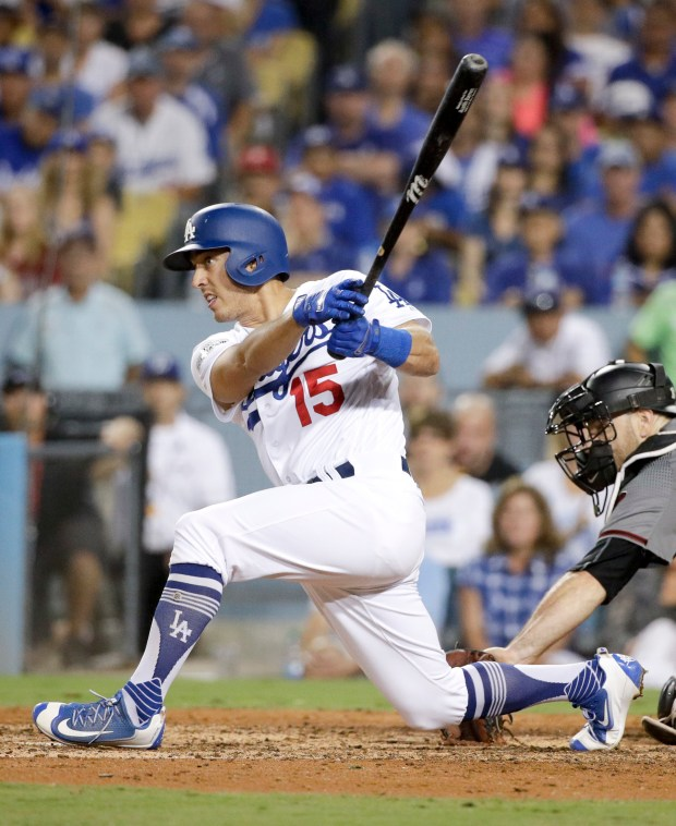 Dodgers catcher Austin Barnes, who went to Riverside Poly High, watches his two-RBI double against the Arizona Diamondbacks during the fifth inning of Game 2 of baseball's National League Division Series in Los Angeles, Saturday, Oct. 7, 2017. (AP Photo/Jae C. Hong)