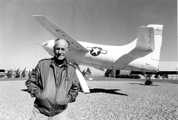 Chuck Yeager, the first pilot to break the sound barrier in 1947, poses in front of the rocket-powered Bell X-IE plane that he flew at Edwards Air Force Base on Sept. 4, 1985. (AP Photo/Douglas C. Pizac)