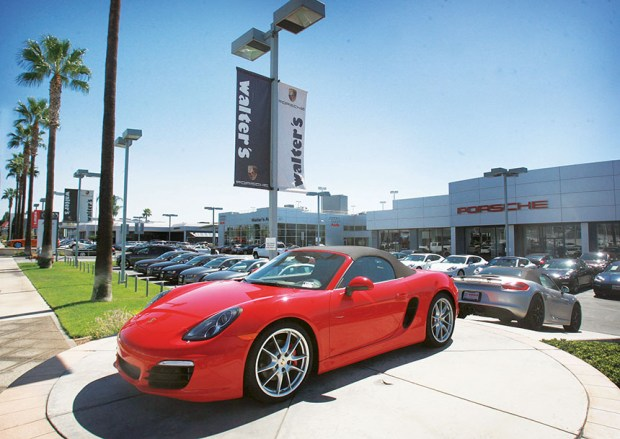 A new Porsche sits on display at the Walter's Porsche dealership in the Riverside Auto Center on Tuesday, Sept. 9, 2014. ORG XMIT: -OPQpfFBROtCW7mvePmH