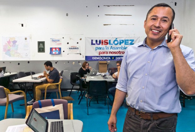 In this Thursday, Sept. 28, 2017, photo, Luis Lopez, candidate for the California State, Assembly District 51, calls voters at his campaign's headquarters in Eagle Rock neighborhood of Los Angeles. Lopez is running in the special election in Los Angeles to replace Congressman Jimmy Gomez (CA-34). Thirteen candidates are competing in Tuesday's Oct. 3, special primary election for a Los Angeles seat in the California Assembly. Ten are Democrats, making the party likely to hold a position that puts them one member over the supermajority threshold Democrats hold in both of California's legislative chamber. (AP Photo/Damian Dovarganes)