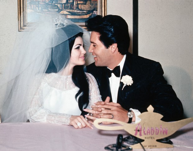 "FILE - In this May 1, 1967, file photo, singer Elvis Presley and his bride, the former Priscilla Beaulieu, appear at the Aladdin Hotel in Las Vegas, after their wedding. Presley, 32, and Beaulieu, 21, both from Memphis, Tenn., met while he was stationed in Germany with the U.S. Army. The new Elvis Presley's Graceland Wedding Chapel at the Westgate Resort & Hotel in Las Vegas is scheduled to open on Thursday, April 23, 2015, as part of the new ""Graceland Presents ELVIS: The Exhibition - The Show - The Experience"" in Las Vegas. (AP Photo/File)"