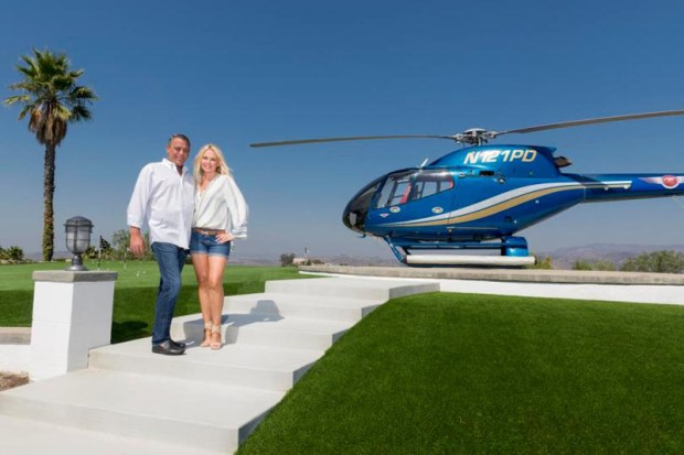 Tim and Kristy Yale next to the helicopter on their helipad at their Cowan Heights home taken on Tuesday, September 6, 2016. (Photo by Leonard Ortiz, Orange County Register/SCNG)