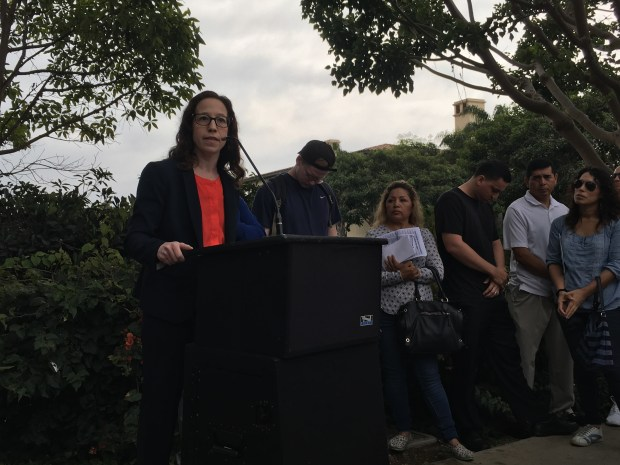 Attorney Lauren Teukolsky speaks at a press conference at Terranea Resort Thursday. Resort workers filed a class-action suit alleging wage violations by the luxury hotel.