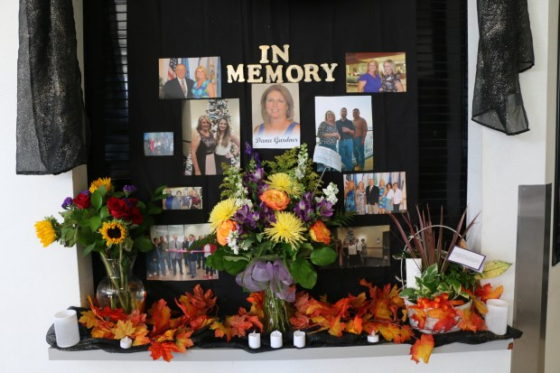 A memorial shrine for San Bernardino County Deputy Recorder Dana Gardner, killed in Sunday night's mass shooting in Las Vegas, has been placed at the entrance to the county Hall of Records building, which houses the Recorder's Office.