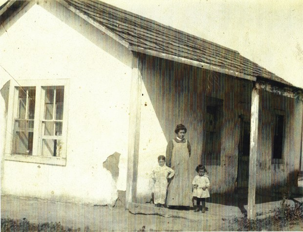 Eloise, Ted and Olive Trujillo stand in front of their Riverside adobe in Riverside in 1909 or so.