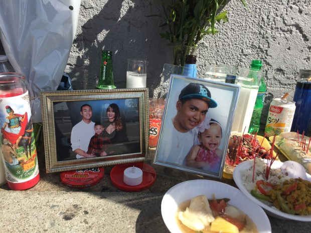 A shooting at a Long Beach liquor store left 21-year-old Danny Bunthung and 22-year-old Dallas Som dead on Tuesday, Oct. 10, police said. Mourners set up a memorial on the sidewalk outside. (Jeremiah Dobruck/Press-Telegram)