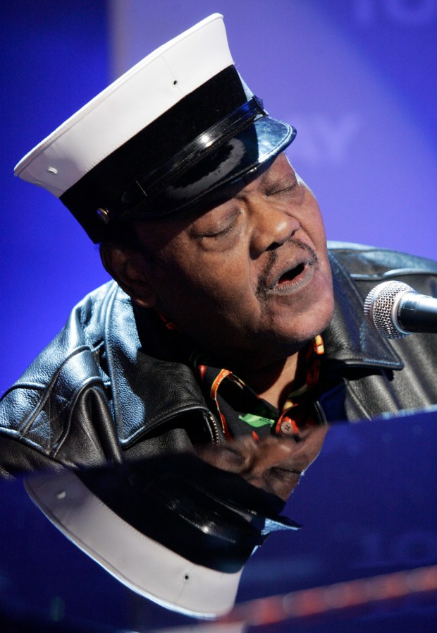 "In this Nov. 9, 2007 file photo, music legend Fats Domino performs on the NBC ""Today"" television show in New York. (AP Photo/Richard Drew, File)"