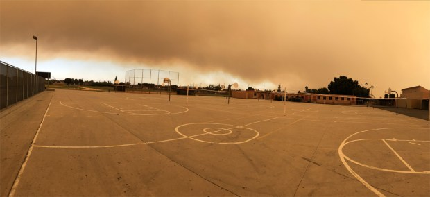 The scene at Orange High on Monday afternoon, looking in the direction of the Canyon 2 Fire. (Photo courtesy of Alicia Seevers)