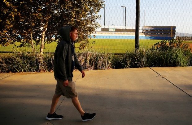 """Julio Marin, 34, of Azusa walks past a replica of Yankee Stadium at Big League Dreamers in West Covina, Calif. on Monday, Oct. 2, 2017. Big League Dreamers was featured in the CW's """"Crazy Ex-Girlfriend."""" (Correspondent photo by Trevor Stamp)"""