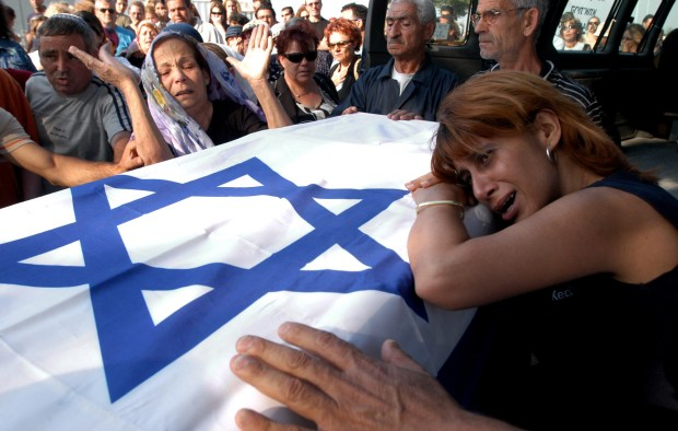 Relatives of Bat-El Ohana carry her coffin during her funeral in the cemetery of Kiryat Atta, near the northern city of Haifa, Israel, Thursday, June 12, 2003. Ohana, 21, was one of 16 people killed in Wednesday, June 11's bus bombing in Jerusalem. (AP Photo/ Baz Ratner)