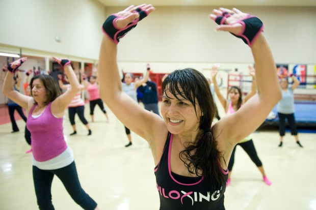 Instructor Ria Vigil-Maddock, of Santa Ana, leads a Piloxing class Photo by KEVIN SULLIVAN / Orange County Register --
