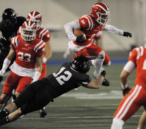 Mater Dei's Amon-Ra St. Brown leaps over Servite's Joe Christensen during the second half. Servite was taking on Mater Dei in a Trinity League game at Santa Ana Stadiumin Santa Ana, on Friday, November 3, 2017. (Photo by Bill Alkofer, Orange County Register/SCNG)