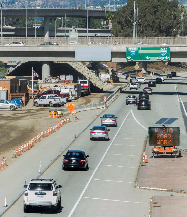A sign W 210 Road Work switching to a new message for the next seven miles construction on the (210) freeway construction Wednesday, November 8, 2017. (Photo by Walt Mancini/SCNG)