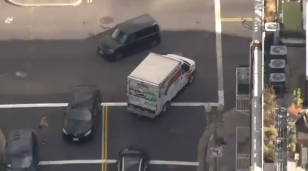 A chase of a woman driving a possibly stolen U-Haul truck from South Los Angeles to the downtown Produce Mart ended after the truck rammed a patrol car and its driver was taken into custody. A shot was fired by an officer, but the suspect wasn't wounded. (Helicopter photo courtesy of KTLA5)