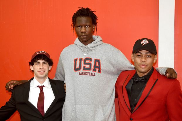 Bol Bol poses with Mater Dei signees after Wednesday's ceremony.  At left is Spencer Freedman (Harvard), at right is Harrison Butler (Southern Utah).  (Photo by Bill Alkofer, Orange County Register/SCNG)
