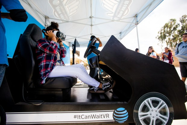 "Jessica Villanueva, 14, tries out the virtual reality distracted driving simulator at Norte Vista High School in Riverside on Thursday, Nov. 9, 2017. The ""It Can Wait"" 360 VR simulator is part of AT&TÕs nationwide tour to raise awareness about the dangers of distracted driving. (Photo by Watchara Phomicinda, The Press-Enterprise/SCNG)"