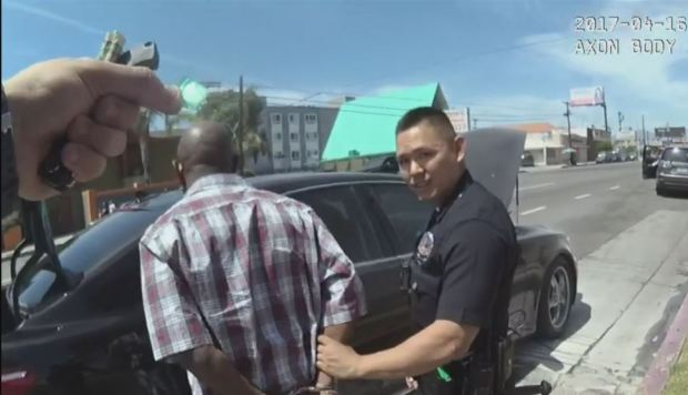 LAPD Chief Charlie Beck says that body camera video doesn't prove that Officer Samuel Lee picked up a small bag that later tested positive for cocaine and placed it in the wallet of suspect Ronald Shields. (Image from video obtained by CBS2)