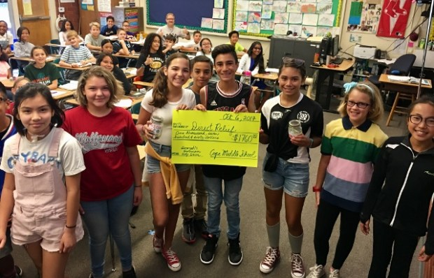 Holding the check are, from left, Emma Moralez, Hamzah Bashir and Bianca Garibay. (Courtesy Photo)