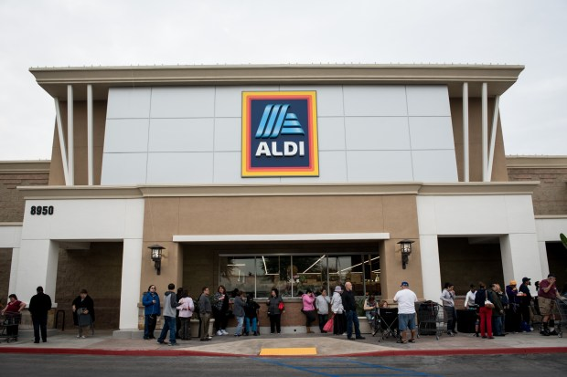 Customers wait outside in anticipation for the grand opening of the Aldi grocery store in Pico Rivera on Thursday, Nov. 16, 2017. The location is the third Aldi in the area, with stores in Santa Fe Springs and Whittier. Customers and staff celebrated the launch a ribbon-cutting ceremony and gift card giveaways. (Michael Ares for the Whittier Daily News/SCNG)