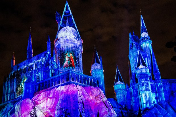"Projected light bathes Hogwarts Castle in holiday cheer animation for ""Christmas in The Wizarding World of Harry Potter"". The light show will take place daily from Nov. 24 to Jan. 7 at Universal Studios Hollywood in Universal City on Thursday, Nov. 16, 2017. (Photo by Matt Masin, Orange County Register, SCNG)"