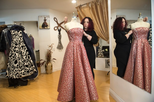 Ludmila Tomashevskay continues her work at her shop Ludmila Couture in Los Angeles on Thursday, Nov. 16, 2017. She opened her Ludmila Couture 20 years ago, since then, she has a long list of celebrity clients, including Madonna, Matt Damon, Jennifer Lopez, Steven Tyler, Christina Aguilera, Miley Cyrus, Kim Kardashian and many others. (Photo by Ed Crisostomo, Los Angeles Daily News/SCNG)