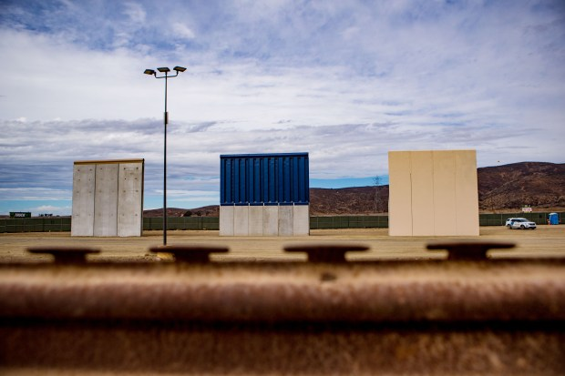 Boarder wall prototypes stand near the primary border structure separating Tijuana, Mexico, and San Diego, California, on Tuesday, Nov. 7, 2017 in Tijuana, Mexico. Eight wall samples as high as 30 feet were recently completed for President Donald Trump's propose border wall with Mexico. (Photo by Watchara Phomicinda, The Press-Enterprise/SCNG)
