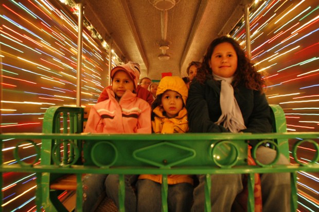 The Christmas Train travels through the tunnel of lights at Irvine Regional Park, which is decked out again for the holidays. (Register file photo)