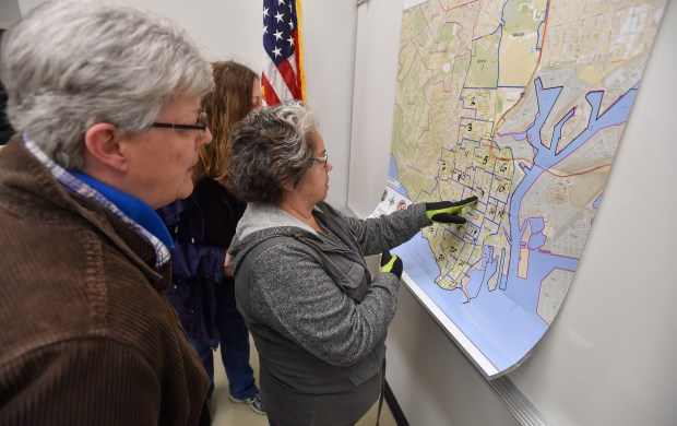 In this Jan. 25, 2017, photo, volunteers look over a map of San Pedro before heading out to count homeless people. (Photo by Scott Varley, Daily Breeze/SCNG)