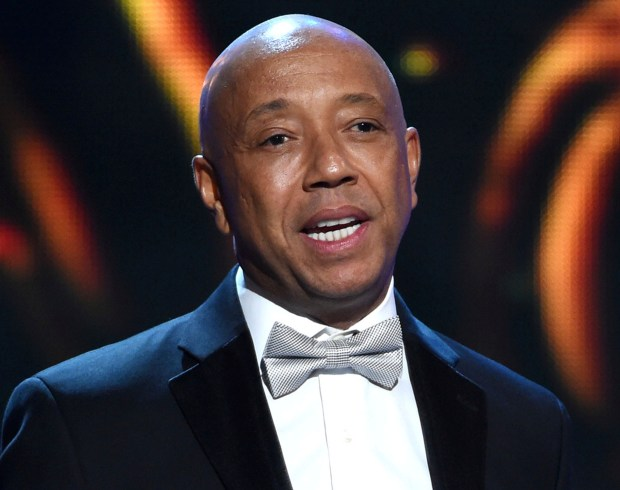 Hip-hop mogul Russell Simmons announced on Nov. 30, 2017, he would be stepping down from companies he founded following a new allegation of sexual misconduct. (Photo by Chris Pizzello/Invision/AP, File)
