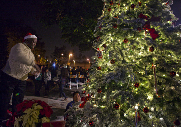 Then-Mayor Al Murray of Tustin sprinkled magic dust during the lighting of the Tustin Christmas Tree in 2012. KEVIN LARA, THE ORANGE COUNTY REGISTER