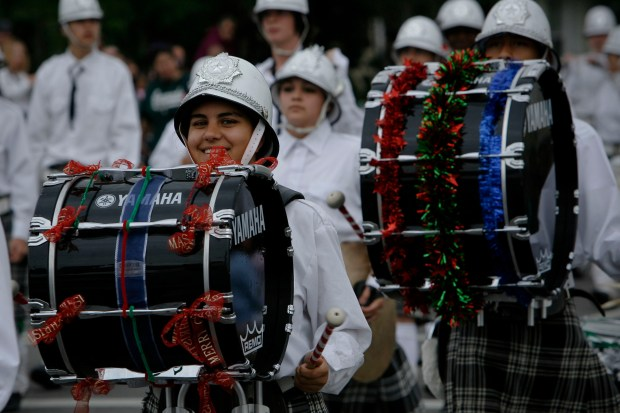 HIGHLANDERS--The Granada Hills Highlander marching band heads down Chatsworth street in the Granada Hills Holiday Parade in Granada Hills sunday. The parade featured a variety of Christmas themed floats and local marching bands. Photo by David Crane/Staff Photographer