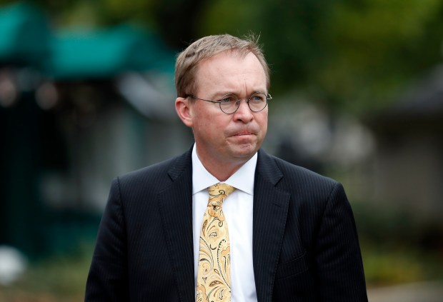 In this Sept. 13, 2017 file photo, Director of the Office of Management and Budget Mick Mulvaney departs after a television interview at the White House in Washington.  Leandra English, the federal official elevated to the position of interim director of the Consumer Financial Protection Bureau by its outgoing director, filed suit against Trump and  Mulvaney Sunday, his pick as interim director of the agency. (AP Photo/Alex Brandon, File)