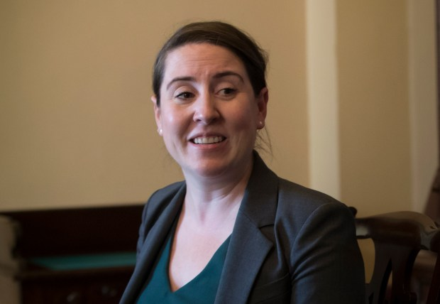 Leandra English, who was elevated to interim director of the Consumer Financial Protection Bureau by its outgoing director, meets with Senate Minority Leader Chuck Schumer, D-N.Y., and Sen. Elizabeth Warren, D-Mass., to discuss the fight for control of the U.S. consumer watchdog's fate after President Donald Trump chose White House budget director Mick Mulvaney for the same post, on Capitol Hill in Washington, Monday, Nov. 27, 2017. (AP Photo/J. Scott Applewhite)
