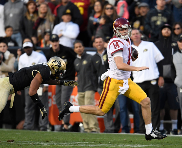BOULDER, CO - NOVEMBER 11: USC Trojans quarterback Sam Darnold #14 eludes Colorado Buffaloes defensive back Evan Worthington #6 for a first down in the third quarter at Folsom Field November 11, 2017. (Photo by Andy Cross/The Denver Post)