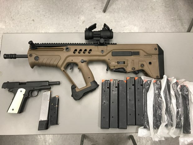 San Bernardino County Sheriff's deputies recovered a loaded assault rifle and loaded handgun from a vehicle a wanted Las Vegas felon was sitting in, officials said. (Courtesy San Bernardino County Sheriff's Department)