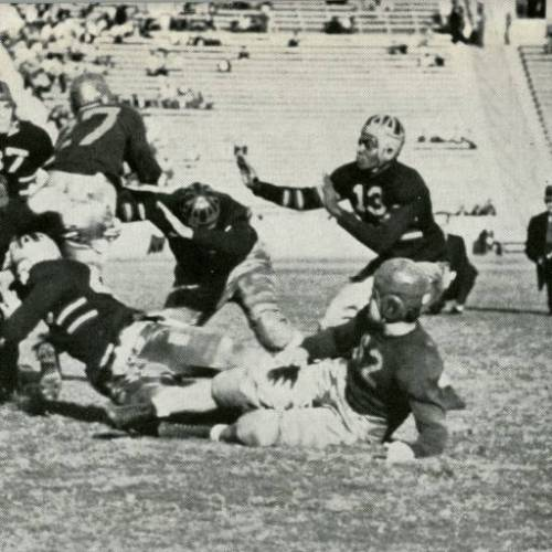 UCLA sophomore left cornerback Kenny Washington (13) moves in to assist on a tackle of USC fullback Bill Sangster (27) at the goal line during the Dec. 4, 1937 game at the Coliseum. (Photo: UCLA Sports)